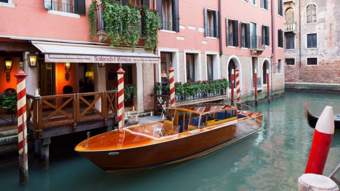 Canal boat arriving to the Splendid Venice hotel's water entrance