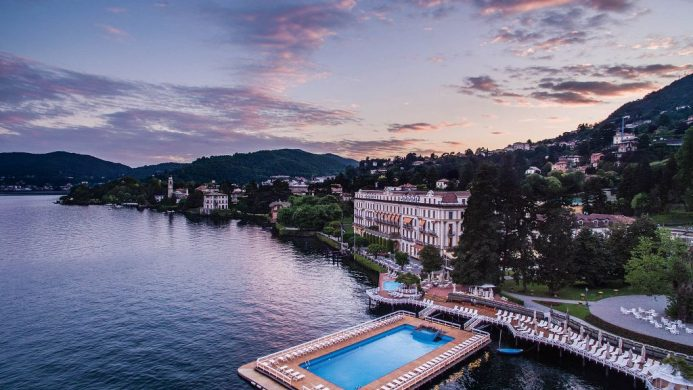 Aerial view of Villa d'Este, floating pool and lake at dusk