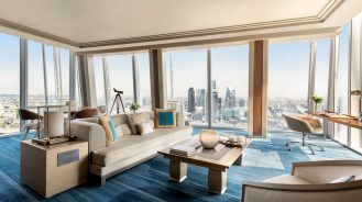 Corner suite with a telescope and floor-to-ceiling windows overlooking the London skyline