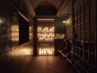 Candlelit crypt with cabinets at the Sinner Paris