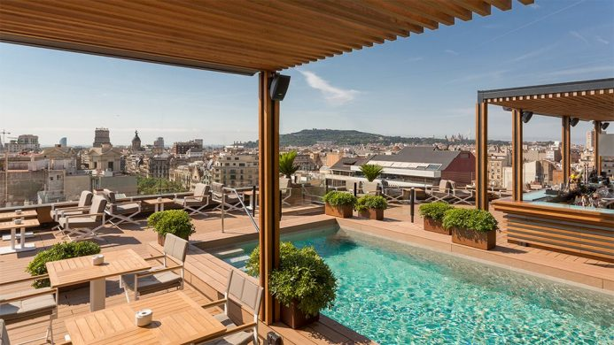 Rooftop terrace with pool at Majestic Hotel and Spa Barcelona