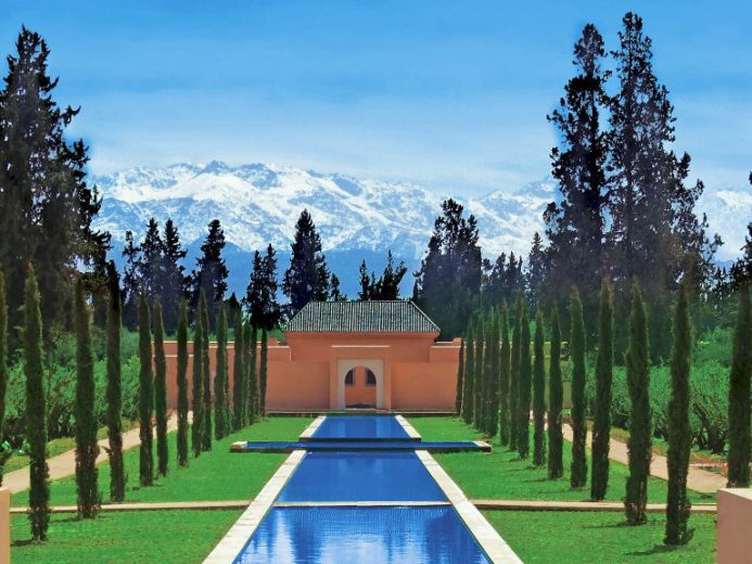 The Oberoi Marrakech view of grand canal and snowcapped mountains