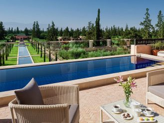 The Oberoi Marrakech Royal Suite Terrace overlooking gardens and man-made canal