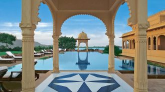 The Oberoi Udaivilas pool with traditional arches