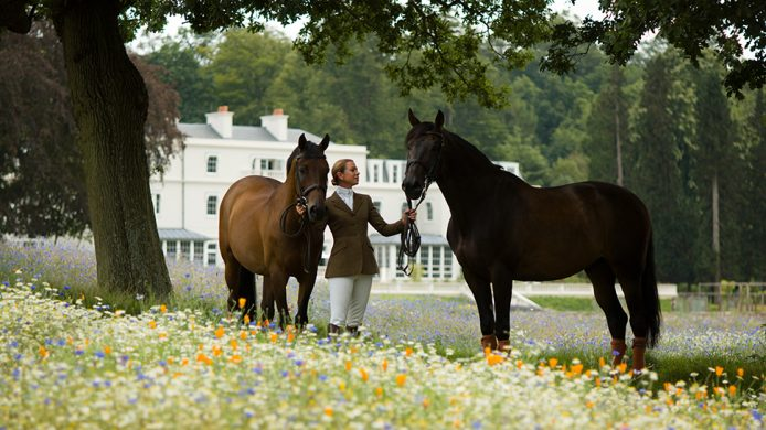 Rider with two horses in front of Coworth Park