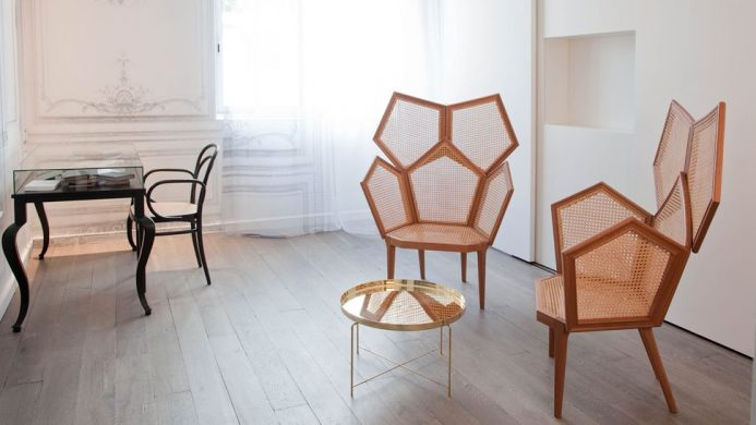 Geometric design chairs in minimal room at La Maison Champs Élysées
