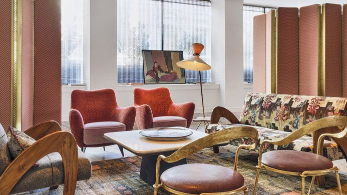 Sitting area with art and mid-century modern furniture at the San Francisco Proper hotel