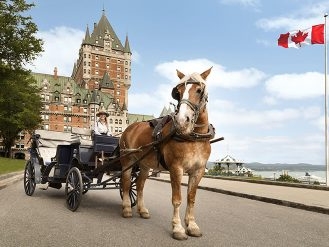 Horse drawn carriage in front of the Fairmont Le Chateau Frontenac