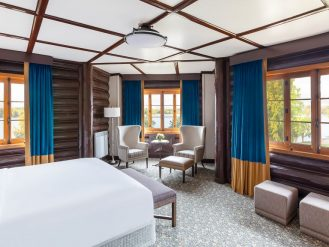 Blue room with wooden log walls at Fairmont Le Chateau Montebello