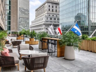 Terrace Bar at the Fairmont The Queen Elizabeth with Montreal buildings in the background