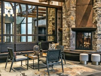 Lobby lounge at Fairmont Tremblant with stone columns and fireplace