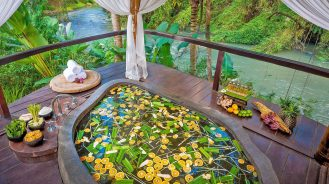 Fivelements Bali spa bath hanging over river stream