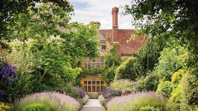 Belmond Le Manoir Aux Quat'Saisons peeking behind lush gardens