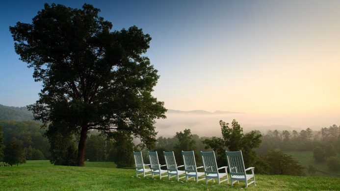 Lawn chairs looking out to smoky hills at Blackberry Farm