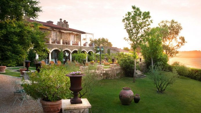 Sunset lawn with potted plants in front of Borgo Santo Pietro