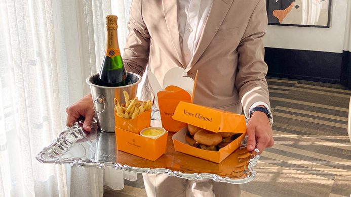 Champagne, burger and fries delivered on a silver platter at the Kimpton La Peer Hotel