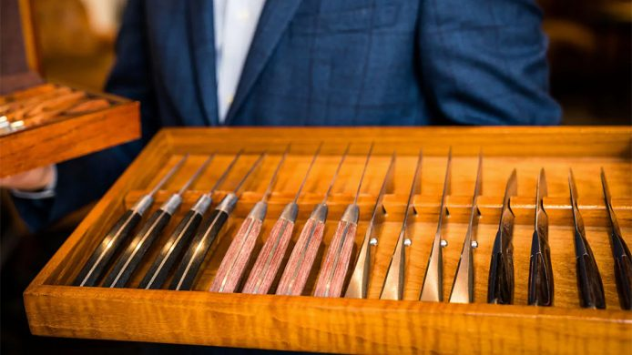 Various steak knives in a wooden box at Park Hyatt Aviara Resort