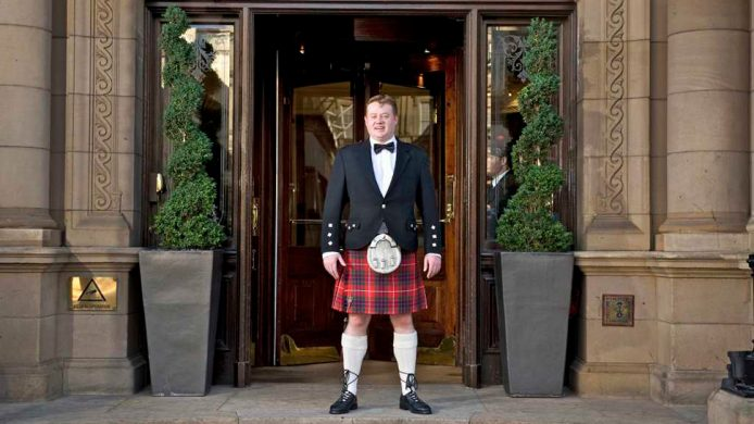 The Tartan Butler in front of The Balmoral