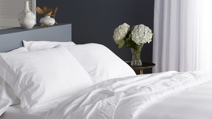 Le Germain hotel's Egyptian cotton duvet cover on bed