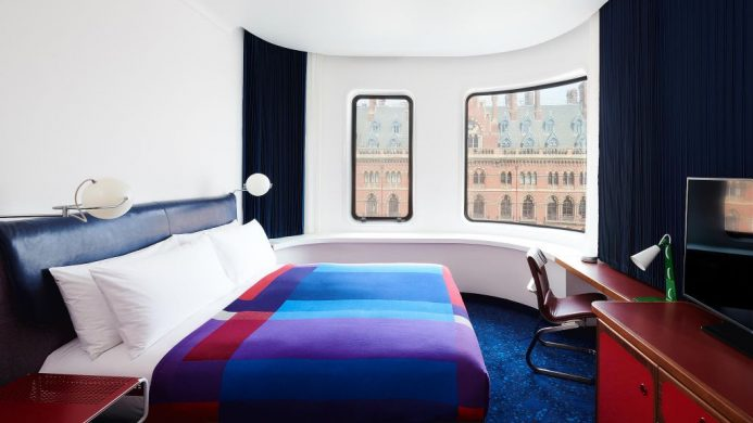 The Standard London's King Room with color-blocked blanket on bed