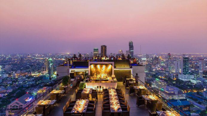 Banyan Tree Bangkok's rooftop Moon Bar towering over the city at dusk