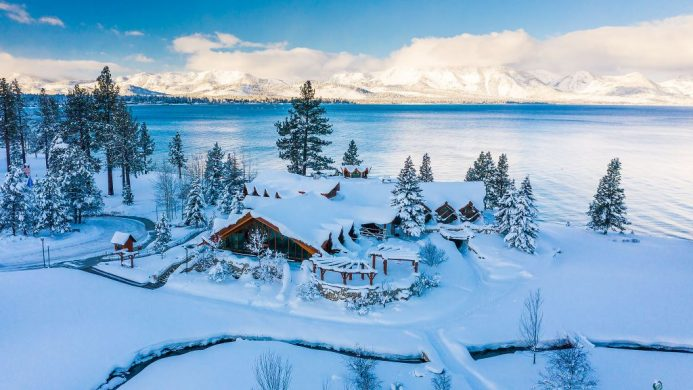 Aerial view of Edgewood Tahoe Resort, Lake Tahoe and mountains glistening in the snow