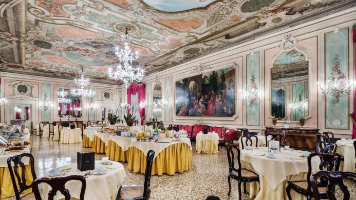 Baglioni Hotel Luna's Marco Polo Room featuring oil paintings on the walls