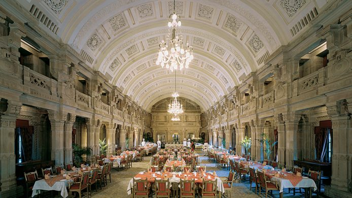 Umaid Bhawan Palace's large banquet hall under a chiselled vaulted ceiling