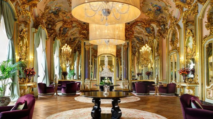 Villa Cora's Mirror Room with golden Baroque walls and ceilings