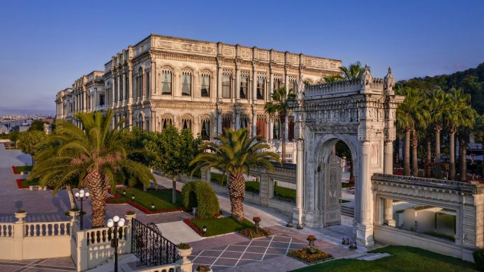 Exterior of Ciragan Palace Kempinski Istanbul with palm trees