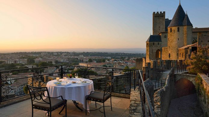 Hôtel de la Cité sunset dining overlooking castle walls