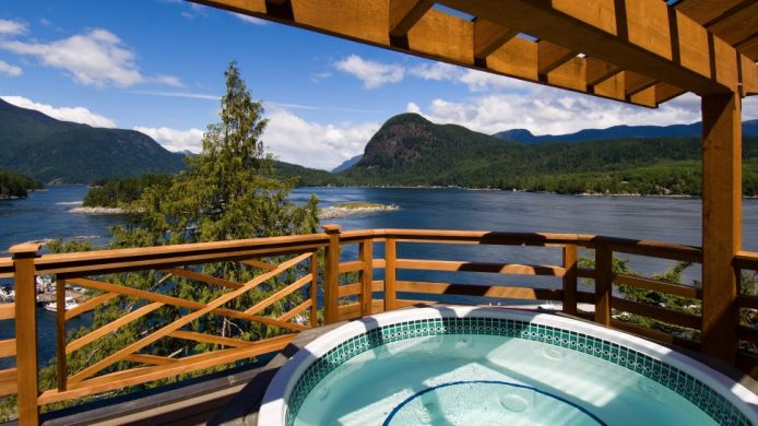 Sonora Resort's hot tub overlooking water and green land