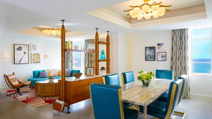 The Confidante's suite room with mid-century modern furniture