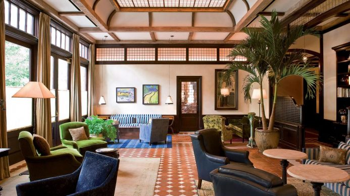 The Greenwich Hotel's lobby lounge with old style furniture and wooden wall and ceiling beams