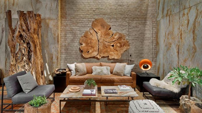 1 Hotel Central Park's lobby decorated with a brown leather couch, live-edge woods and potted plants