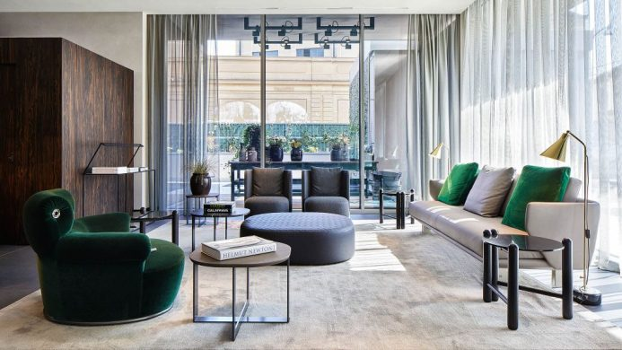Hotel Viu Milan's lobby filled with bespoke furniture and flooded with natural light
