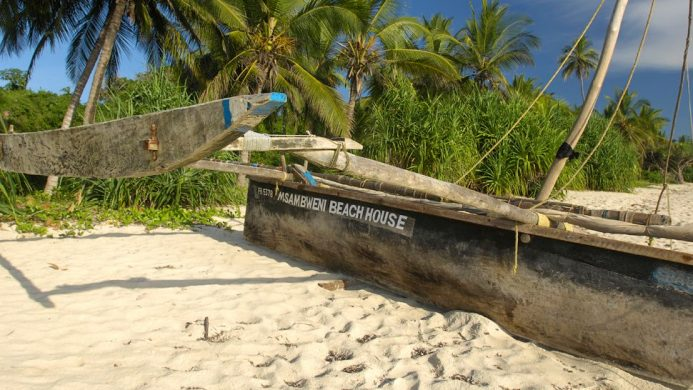 Msambweni Beach House-branded wooden boat stranded on the beach