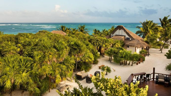 Mukan Resort on a white sand beach surrounded by many trees