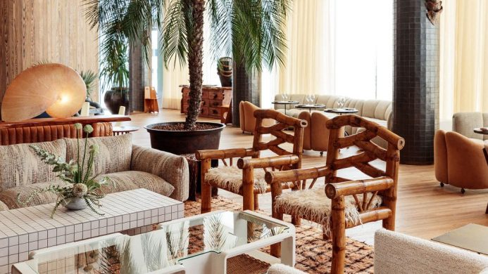 Santa Monica Proper Hotel's lobby and Palma lounge with white sofas and a palm tree